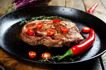 Cooking a steak in a frying pan