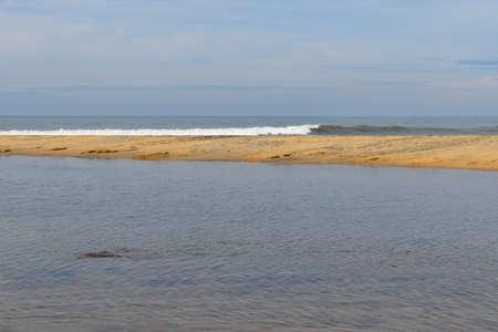 Tropical Sand beach background with long sand beach blue ocean and sky horizon india kerala varkala