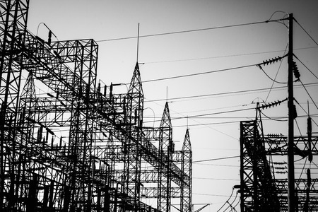 electrocute: Electrical substation silhouette in black and white