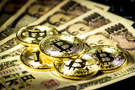 Bitcoin and 10000 Yen bills