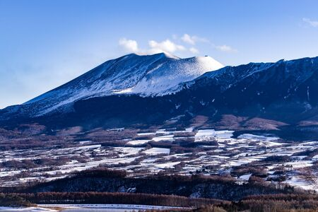 Mt. Asama, an active volcano in Japan with snow