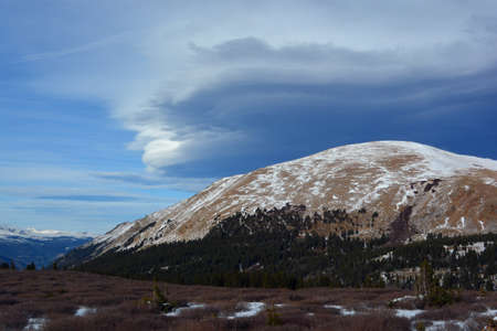 lenticular: Strange Lenticular Clouds Over a Snow Covered Mountain Top
