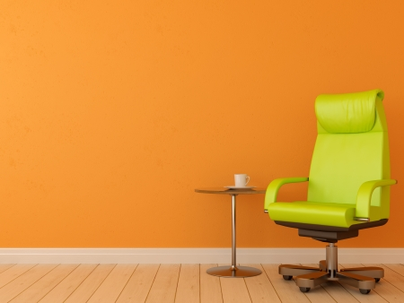 creates: Comfortable office chair with table creates a contrasting composition against an orange wall