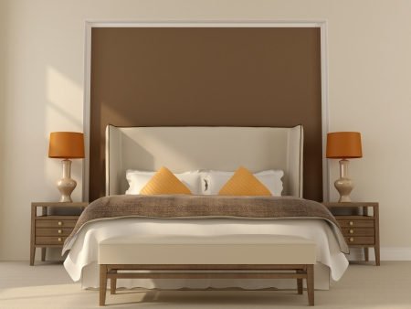 Bedroom in beige and brown colors with orange decoration photo