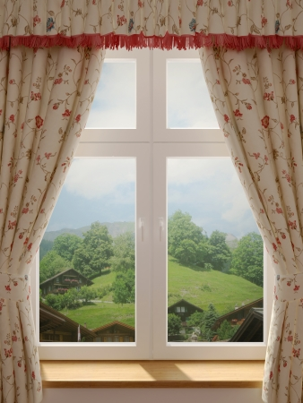 Window with a wonderful view of the village and decorating in country style curtains photo