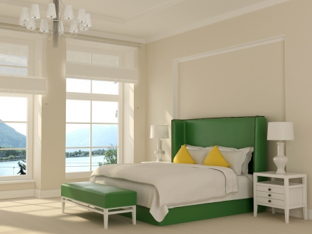 A spacious room in white with large windows and a focus on the green bed photo