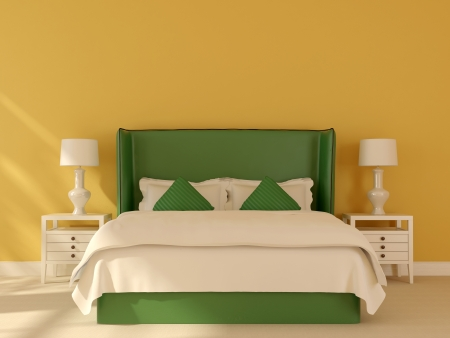 Bright interior composition, which consists of a green bed and white bedside tables with reading lamps on the background of bright yellow wall photo
