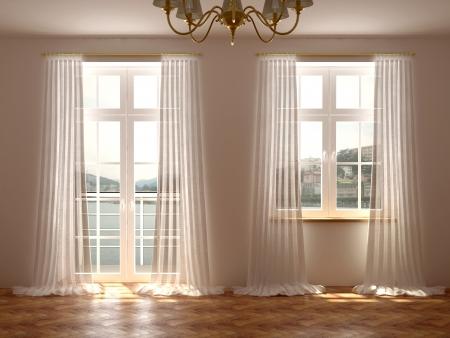 Lege kamer met een prachtig uitzicht vanuit de ramen en balkon deur die zijn versierd met witte gordijnen