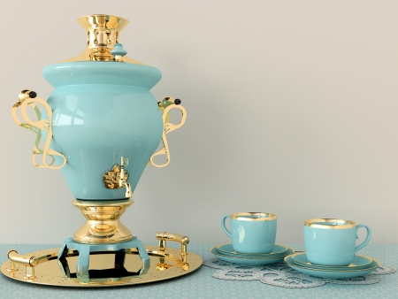 Beautiful samovar with gold and two coffee cups photo