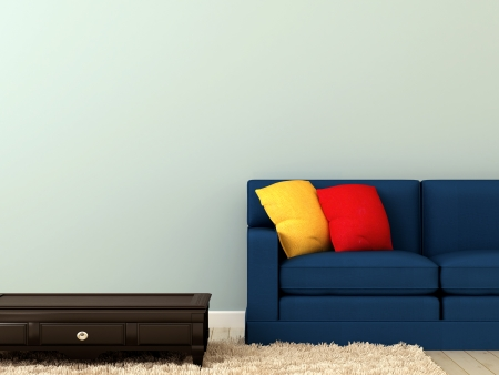 The composition of a sofa and a black table on the white carpet and focus on bright pillows Фото со стока