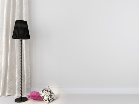 Elegant black floor lamp and colored pillows against a white wall and curtains  Banco de Imagens