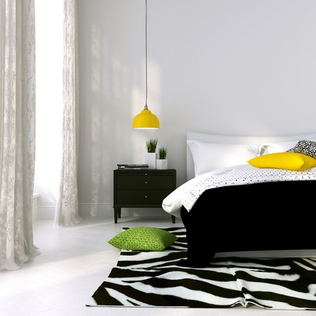 Bedroom in black and white with the yellow lamp and colored cushions photo