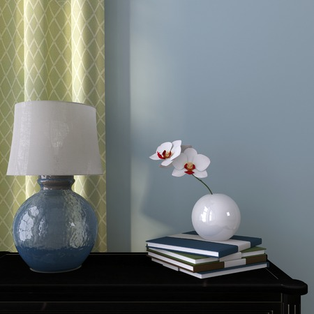 chest of drawers: Beautiful lamp on a background of blue wall and green  curtain Stock Photo