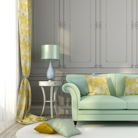 Classic interior with a beautiful green sofa and a table lamp beside