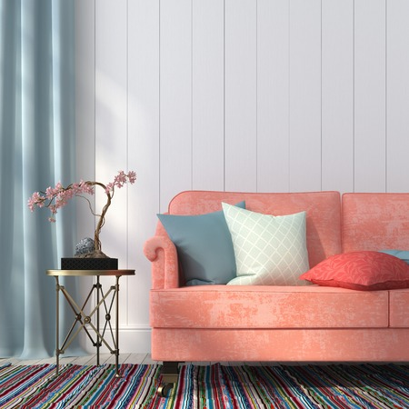 Classic salmon-colored sofa and gilded table on the background of a wall paneled wood  boards