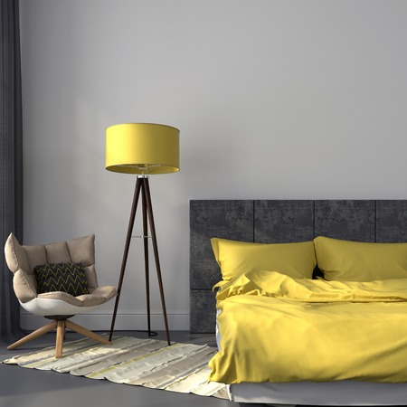 Modern bedroom in gray color and accents on yellow lamp and bedclothes photo
