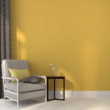 White armchair and a dark wooden table against a background yellow wall