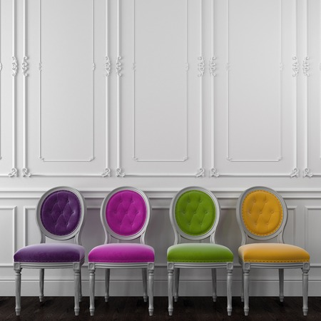 Four classic chair on a white wall, which is decorated with moldings