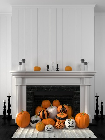 Beautiful white fireplace in the classic style against a white wall and decorated with painted pumpkins