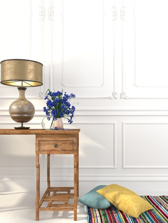 Vintage table and a fashionable table lamp made from brass against a white wall 스톡 콘텐츠