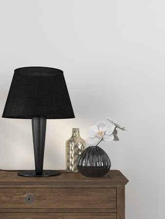 chest of drawers: Trendy table lamp and decor against a white wall