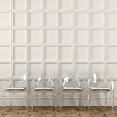 wall decor: Fashionable transparent chairs against a white wall with decor Stock Photo