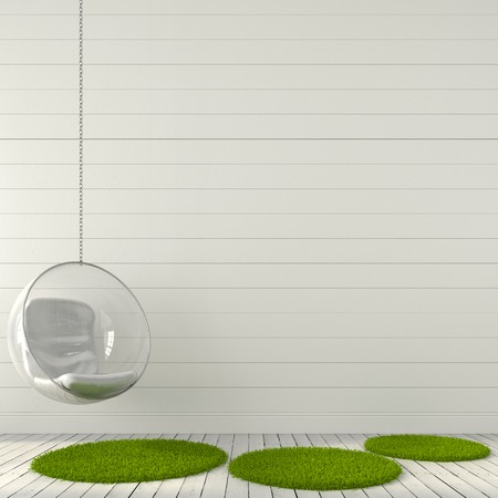 Transparent hanging chair against a white wall and floor with green carpet