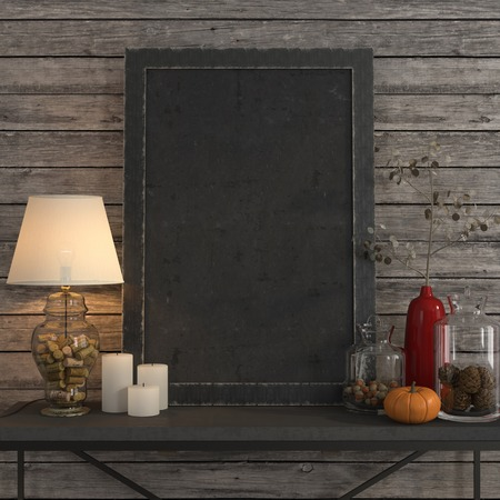 Mock up poster frame on the metal table with a table lamp and an autumn decor