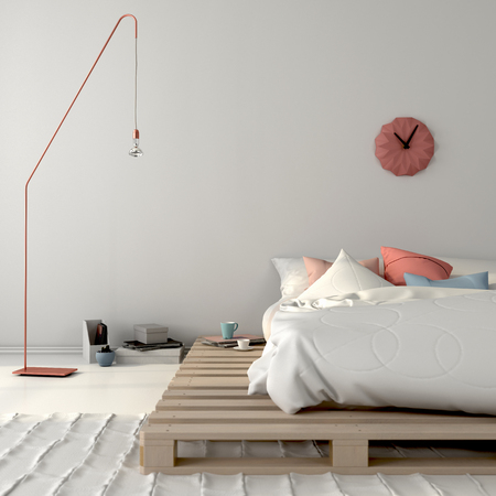 Stylish white bedroom with a bed on wooden pallets and pink décor