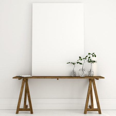 Mock up of a white canvas, on which may be your text, standing on a wooden table in a bright interior