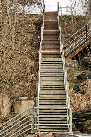 well known: A set of almost endless steel stairs rises from one street to another in the exceedingly hilly terrain of Manayunk PA, one of Philadelphias most well known neighborhoods.