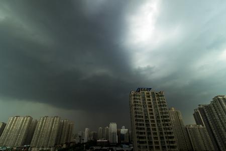 cityscape under dark cloud