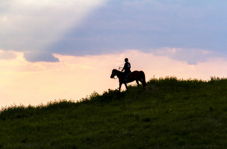 horse riding under the sunset