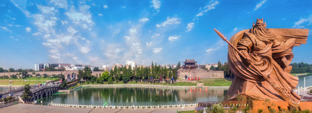 The statue of Guan Gong and the ancient city of Jingzhou sunny days