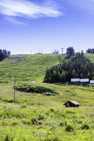 The slopes of a ski resort are quite empty in the summertime  Wonder why