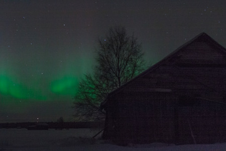 very cold: An old barn house and the Northern Lights. A photo taken on a very cold night.