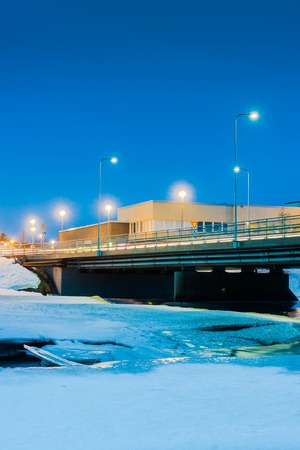 nocturnal: Nocturnal view of the bridge crossing the icy river Pyhajoki in the Northern Finland.