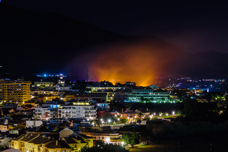 bush fire: All of a sudden a fire broke out in the hills at Fuengirola, Spain. Luckily, nobody was hurt, but many people were evaquated from their homes. The flames looked very impressive behind the buildings.