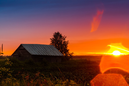 emphasizes: The bright sunset of the Finnish summer produced lens flare which just emphasizes the beautiful colors of the sky.