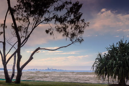 coolangatta: You can see the Gold Coast skyline bathing in the sunset from the beach in Coolangatta, Queensland, Australia. Stock Photo