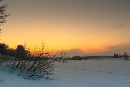bend over: The sun rises behind the river bend over the icy river Pyhajoki in the Northern Finland. Stock Photo