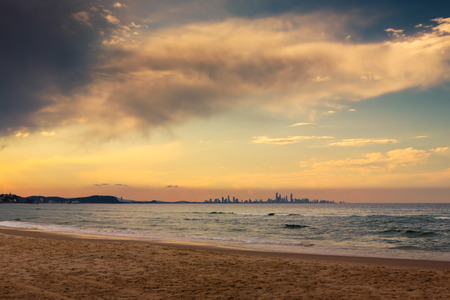 qld: The skyline of the city of Gold Coast can be seen in the horizon from a beach in Coolangatta, QLD, Australia. A place well worth visiting. Stock Photo