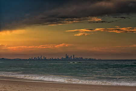 coolangatta: The skyline of the Gold Coast City seen from a beach in Coolangatta, Queensland, Australia. The sunset was quite spectacular.