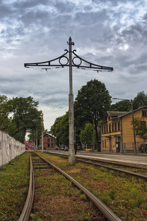 Old rails of a tram line in the Kalamaja area in Tallinn, Estonia. The line seems not to be in use at the moment.