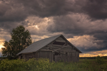 The thunder storm is coming upon the fields of the Northern Finland. Very typical weather on a warm summer day. Stock Photo