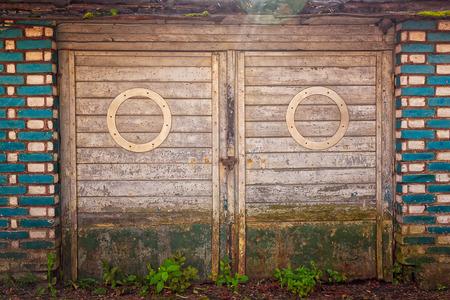 garage doors: Old garage doors look like a big-eyed face. This old building is in Tallinn, Estonia.