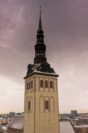 The tower of the St. Nicholas Church in Tallinn, Estonia, seen from the Finnish embassy. St. Nicholas Church is a medieval former church in Tallinn, Estonia. Originally built in the 13th century, it was partially destroyed in Soviet Bombing of Tallinn i