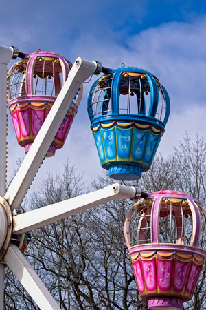 almost all: Three cabins of a ferris wheel in the Kadriorg park in Tallinn, Estonia. The amusement park is in the middle of the old park and its open almost all year round.