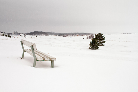 An empty seat in a snowstorm at Kalajoki, Finland