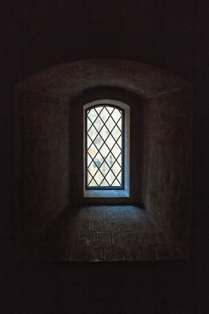 A very old window at the medieval castle of Turku, Finland. The castle is built during hundreds of years and has details like this everywhere. Stock Photo